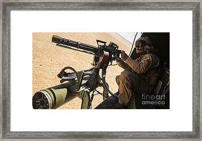 A Crew Chief Mounts A M134 Minigun Framed Print by Stocktrek Images