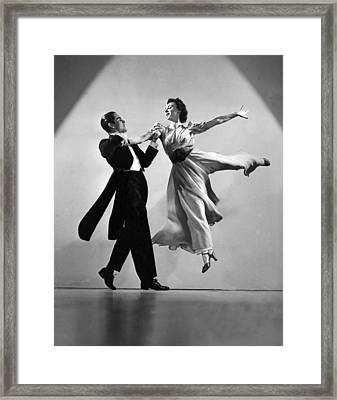 A Dance Team On Stage Framed Print
