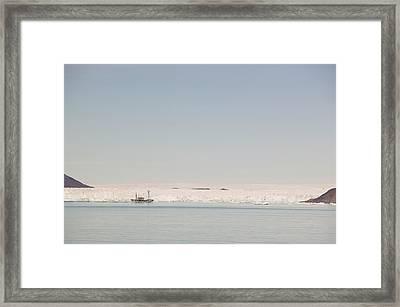 A Danish Navy Vessel Patrolling Framed Print by Ashley Cooper