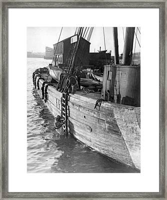A Deep Sea Diver On A Boat Framed Print