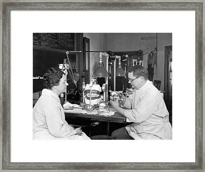 A Dentist Articulates Framed Print by Underwood Archives