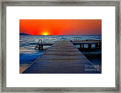 A Digitally Converted Painting Of A Wooden Pier At Sunset Framed Print