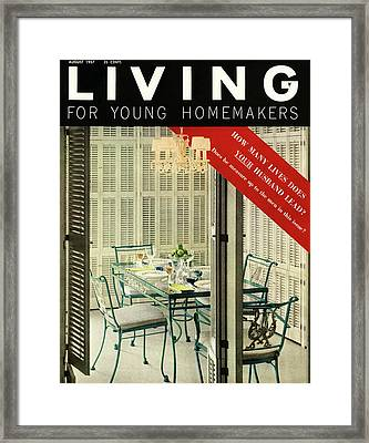 A Dining Room With Furniture By Lee L Woodard Framed Print by Ernest Silva