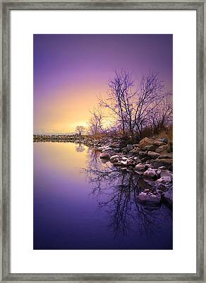 A Distant Glow Framed Print by Tara Turner