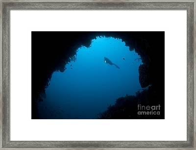 A Diver Explores A Cavern In Gorontalo Framed Print by Steve Jones