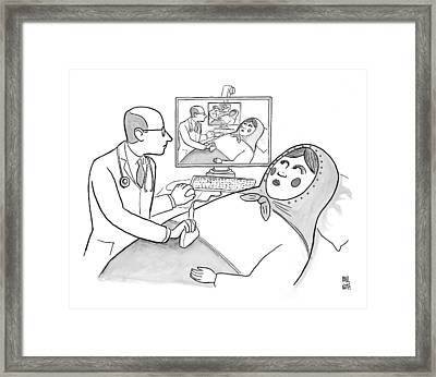 A Doctor Is Seen Giving An Sonogram To A Russian Framed Print