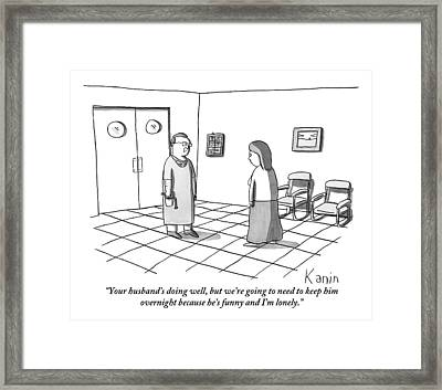 A Doctor Is Seen Talking To A Woman Framed Print