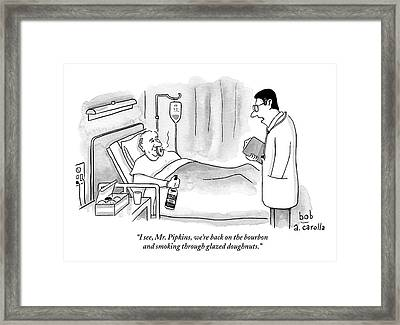 A Doctor Speaks To A Patient In A Hospital Bed Framed Print