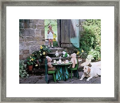 A Dog Sitting Next To Two Teddy Bears Having Framed Print by Ernst Beadle