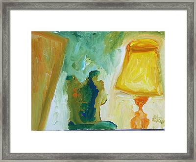 A Door A Chair And A Yellow Lamp Framed Print
