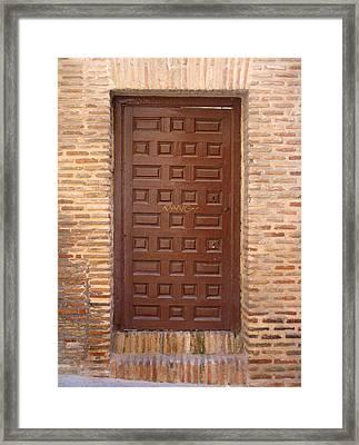 A Door In Toledo Framed Print by Roberto Alamino