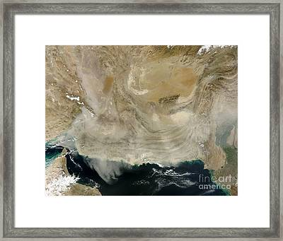 A Dust Storm Stretching From The Coast Framed Print by Stocktrek Images