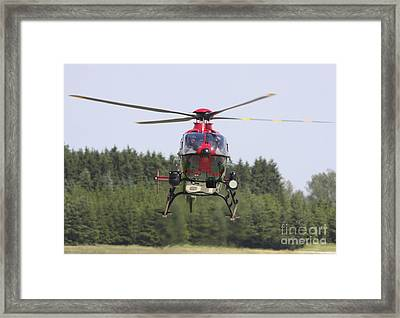 A Eurocopter Ec135 Used By German Framed Print by Timm Ziegenthaler