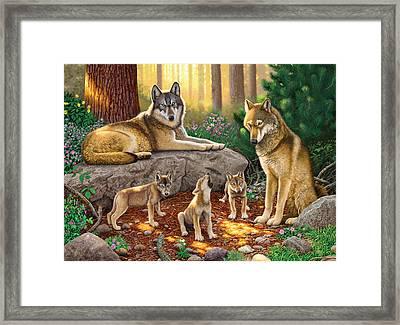 A Family Of Wolves Framed Print by Chris Heitt