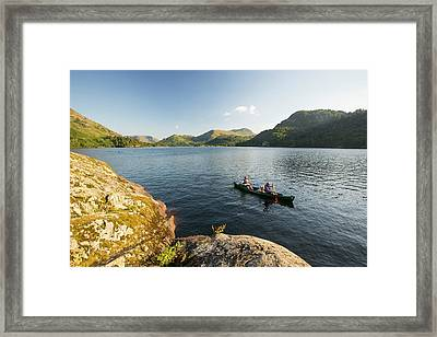 A Family Paddling In A Canadian Canoe Framed Print by Ashley Cooper