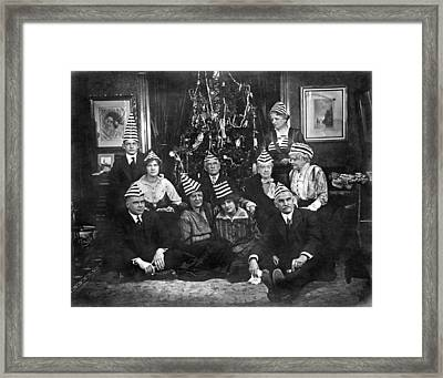 A Family With An Interesting Christmas Tradition Of Strange Hats Framed Print by Underwood Archives