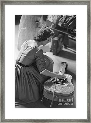 A Fan Touches The Guitar Of Elvis Presley 1956 Framed Print by The Harrington Collection