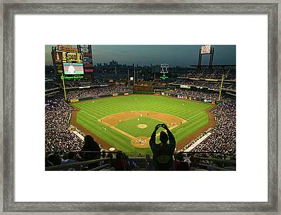A Fan With A Digital Camera Taking Framed Print