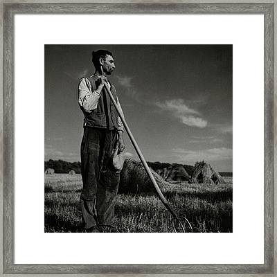 A Farmer Holding A Pitchfork Framed Print by Roger Schall