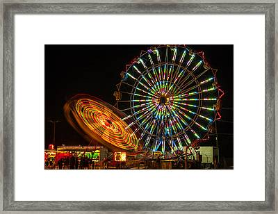 Framed Print featuring the photograph Colorful Carnival Ferris Wheel Ride At Night by Jerry Cowart