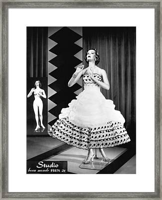 A Fashionable Mannequin And Her Unclothed Version In The Backgro Framed Print by Underwood Archives