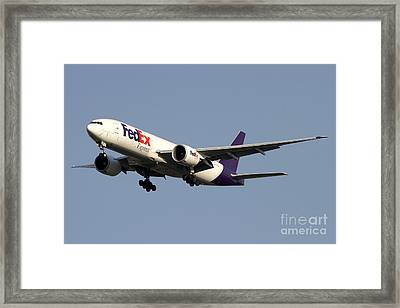 A Federal Express Boeing 777f Cargo Framed Print by Luca Nicolotti