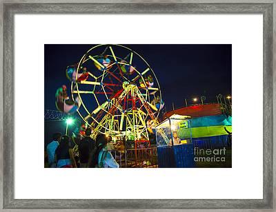 A Ferris Wheel Veers By A Big Folk Festival Framed Print