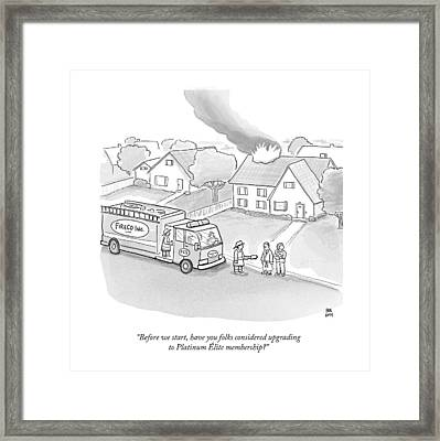 A Fireman Talks To A Family While Their House Framed Print