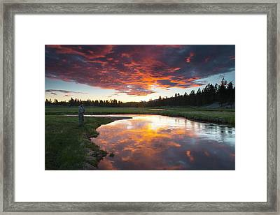 A Fisherman Tries His Luck Framed Print by Robbie George