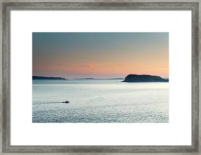 A Fishing Boat Cruises Through Flat Framed Print