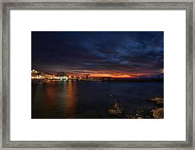 a flaming sunset at Tel Aviv port Framed Print