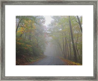 A Foggy Drive Framed Print