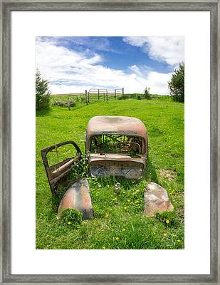 A Ford In A Field Framed Print by Jim Hughes