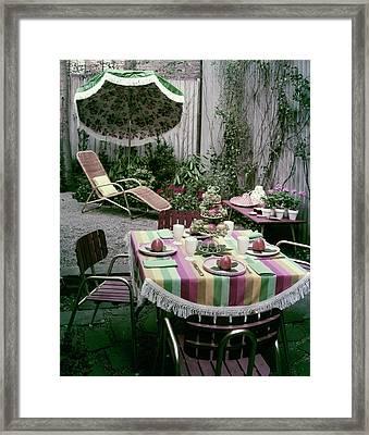 A Garden Set Up For Lunch Framed Print by Tom Leonard