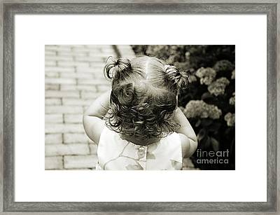 A Girl And Her Curls Framed Print by Andee Design