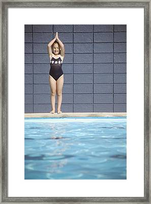 A Girl In The Swimming Pool Framed Print by Kelly Redinger