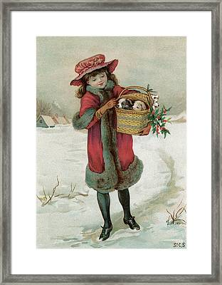 A Girl Walks Through The Snow Framed Print