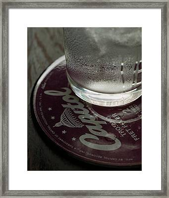 A Glass On A Coaster Framed Print by Romulo Yanes