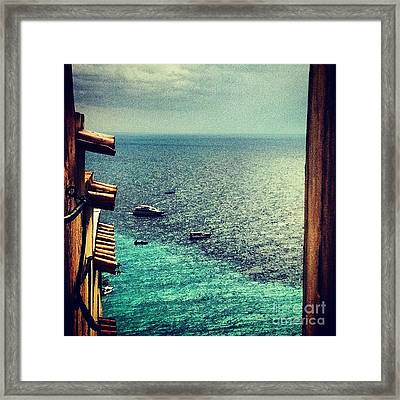 A Glimpse Of Blue Waters Framed Print by H Hoffman