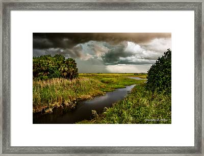 A Glow On The Marsh Framed Print by Christopher Holmes