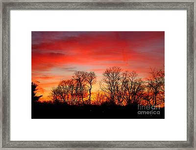 Framed Print featuring the photograph A Glowing January Sunrise by Jay Nodianos