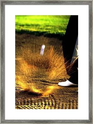 A Golfer Hitting The Ball From A Sand Trap Framed Print by Lanjee Chee