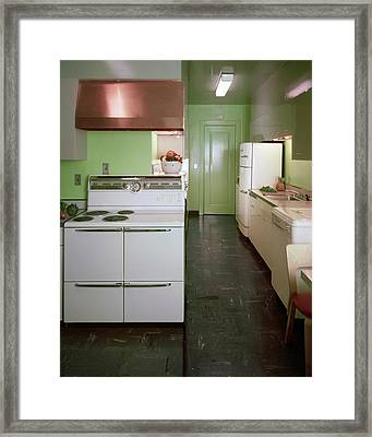 A Green Kitchen Framed Print
