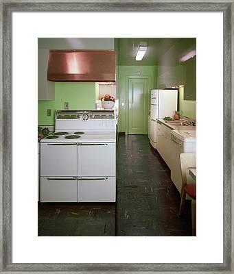 A Green Kitchen Framed Print by Constantin Joff?