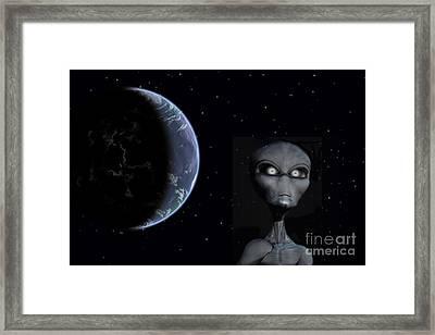 A Grey Alien With Planet Earth Framed Print by Mark Stevenson