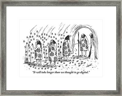 A Group Of Cave Dwellers Are Seen Drawing Notches Framed Print