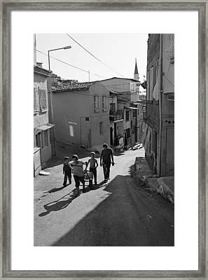 A Group Of Children In Kadifekale District In Izmir Framed Print by Ilker Goksen