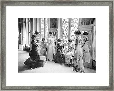 A Group Of Mannequins Relax  And Chat Framed Print by Mary Evans Picture Library