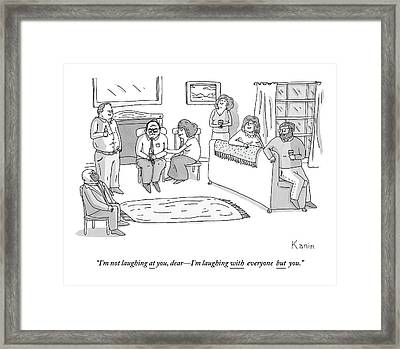 A Group Of Men And Women Are Sitting Framed Print by Zachary Kanin
