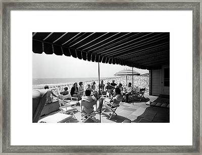 A Group Of People On A Terrace Overlooking Framed Print
